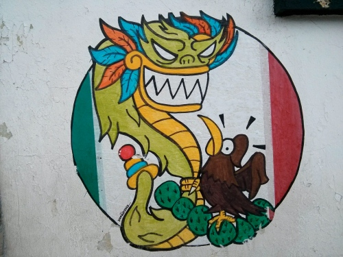 The Mexican flag features an eagle devouring a serpent (on top of a Nopal). This is a slightly different take.