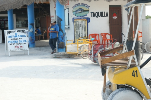 Here's the other place to buy ferry tickets in Holbox. They are right next to each other - you can see the schedule next to the guy.